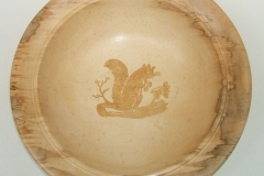 This pale plate is made from the sap wood of a Walnut tree, the central design was created using a laser.